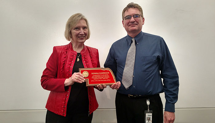 photograph of Ed Toner presenting award to Donna Hammack